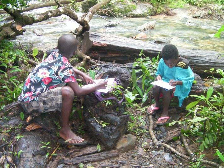 Children learning stream ecology.